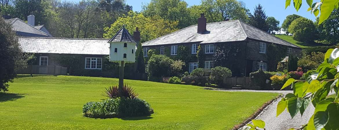 The main lawn, dovecote and cottages
